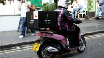An UberEATS food delivery courier rides her scooter in London, Britain September 7, 2016.  REUTERS/Neil Hall