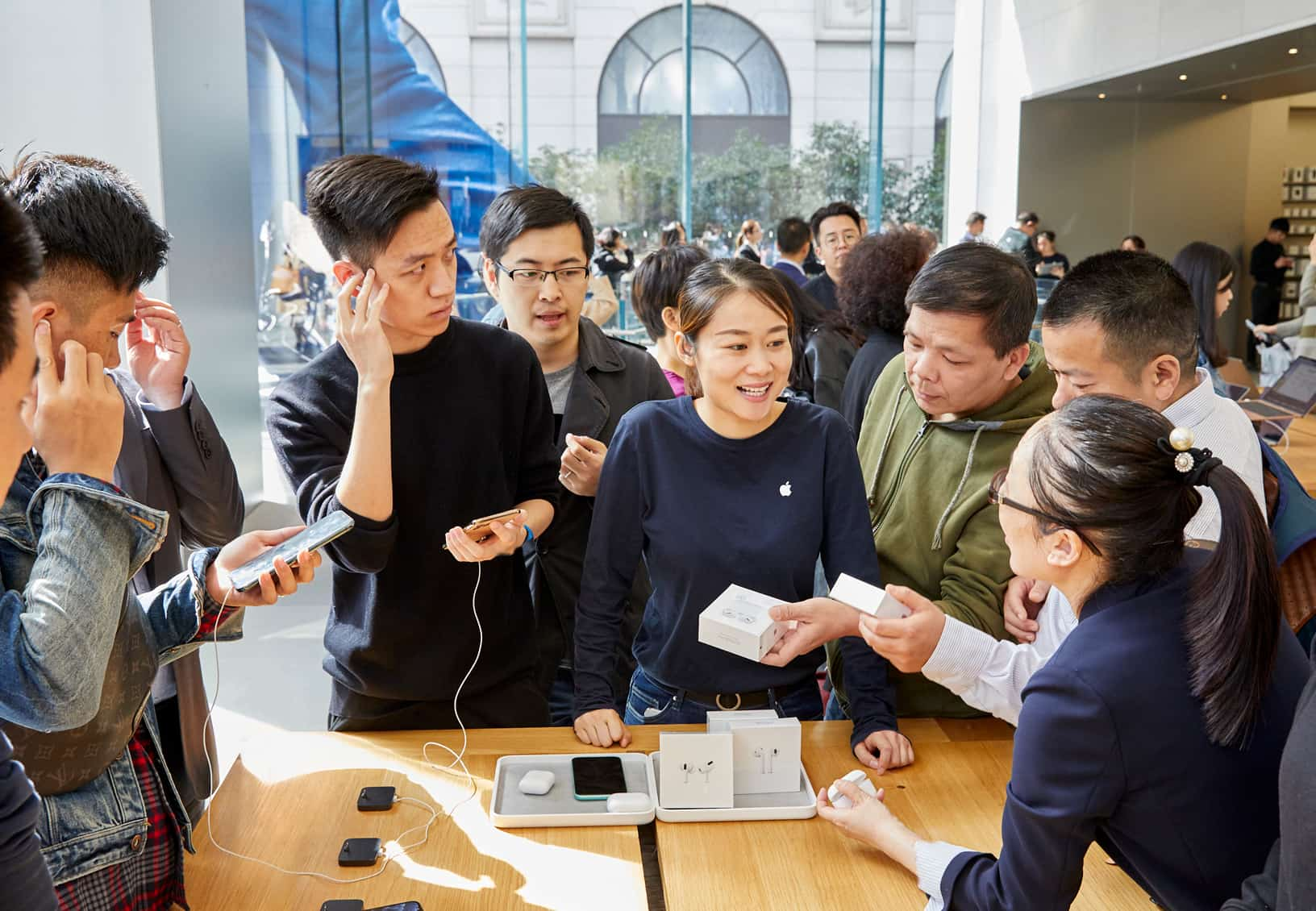 Apple Airpod Pro Launch Shanghai Guests With Team Member At Product Table 10302019